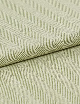 Green coloured fabric that has a pattern of fine stripes