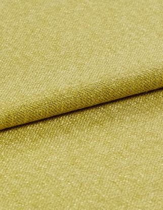 The yellow Lindora Husk fabric with a fold