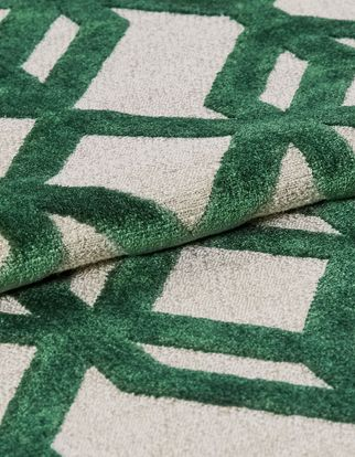 White fabric that is designed with a repeating green braid pattern
