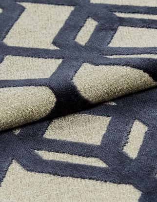 Cream fabric with a repeating dark blue geometric pattern