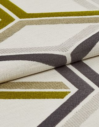 Cream coloured fabric with a repeating geometric pattern in yellow, grey and neutral tones