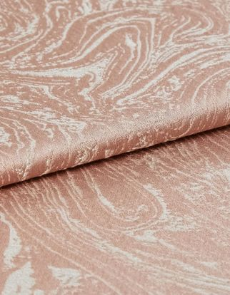 Pink and white combined in a swirling pattern that repeats throughout the material