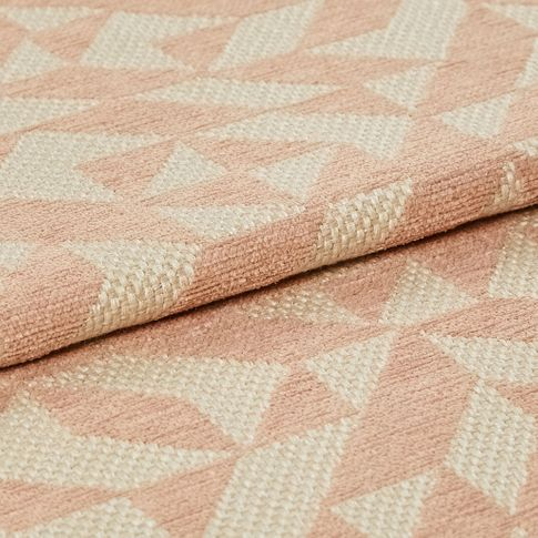 Folded over material which is designed in cream and light pink in a repeating geometric pattern