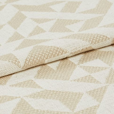 Beige and white fabric with a repeating geometric pattern