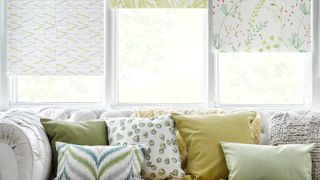 3 different types of Hillarys Floral Blinds in a window behind a sofa
