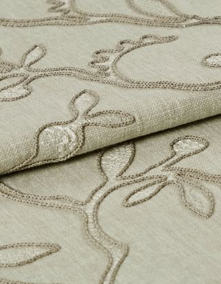Adhara silver birch fabric which is decorated in a neutral colour with an intricate branch design that is woven across the entire material