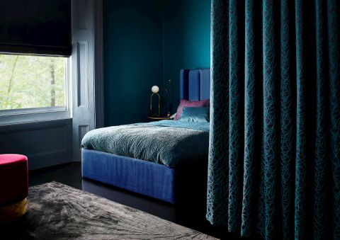 Roman blinds in Titan Nightgaze with curtains in Zodiac Deep Cyan