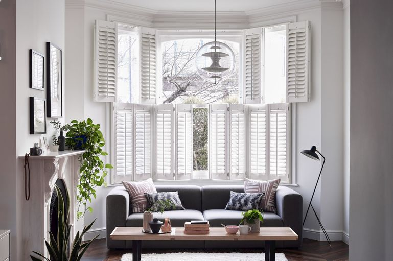 white luxe shutters in a living room