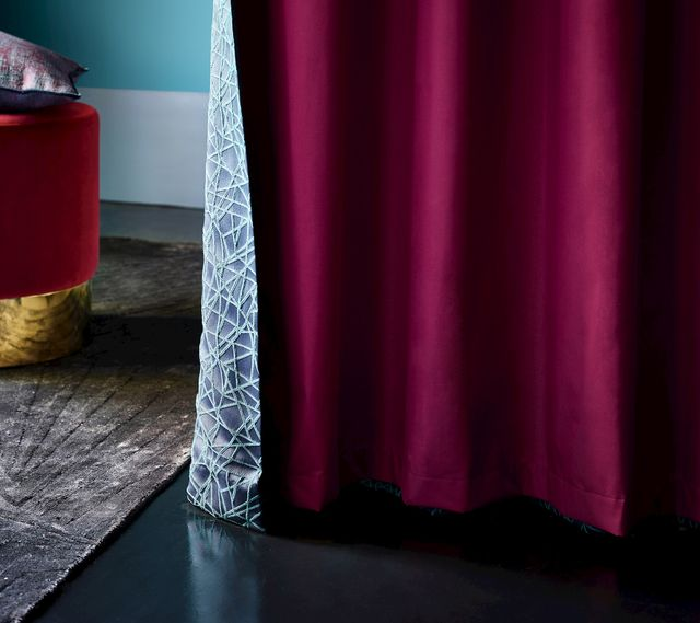 Maroon silk curtain with deep creise cyan lining in a bedroom