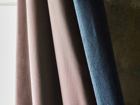 Blue geometric patterned curtain with a beige lining