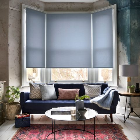Kilner Captain Blue Roller blind in a living room bay window
