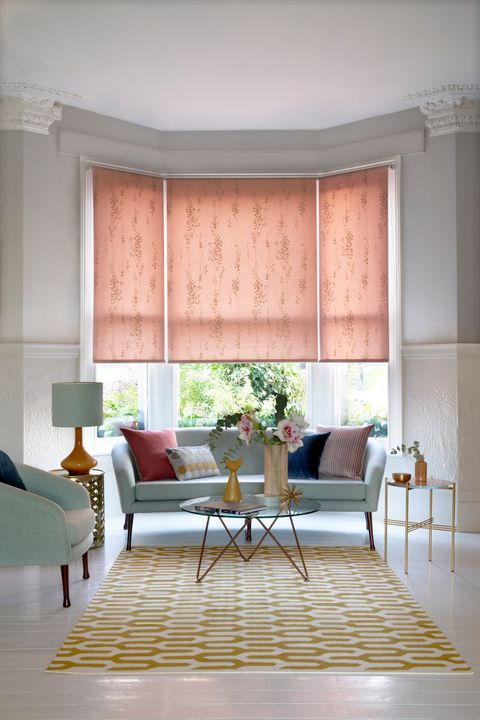 Somma Blush roller blind in a living room bay window