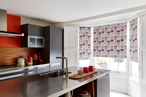Imrie Scarlet roller blind in a kitchen bay window