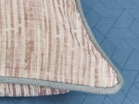 red and white striped cushion with a silver piped edge