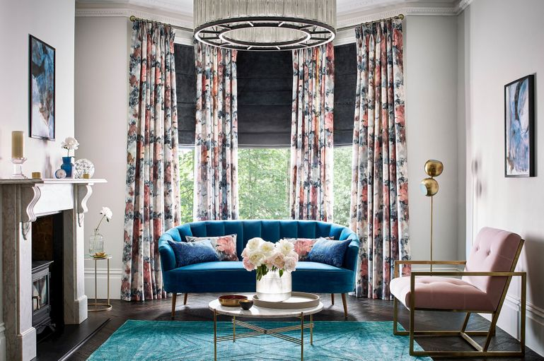 full length floral curtains in an elegant living room window
