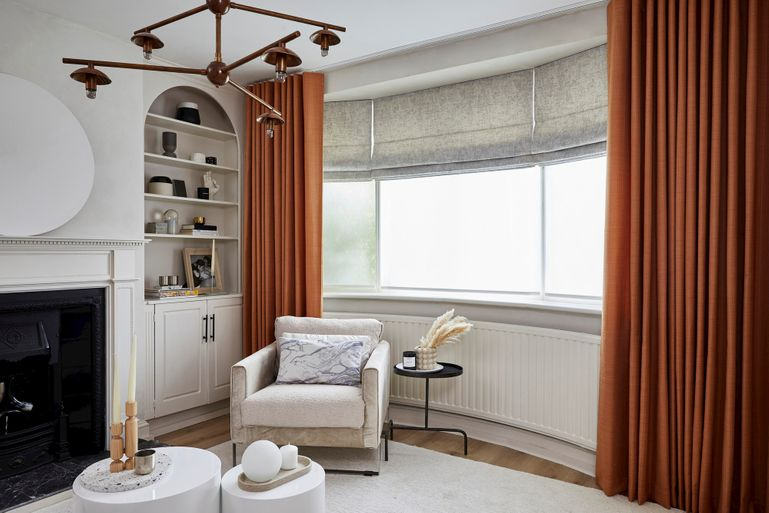 White living room with gold curtains