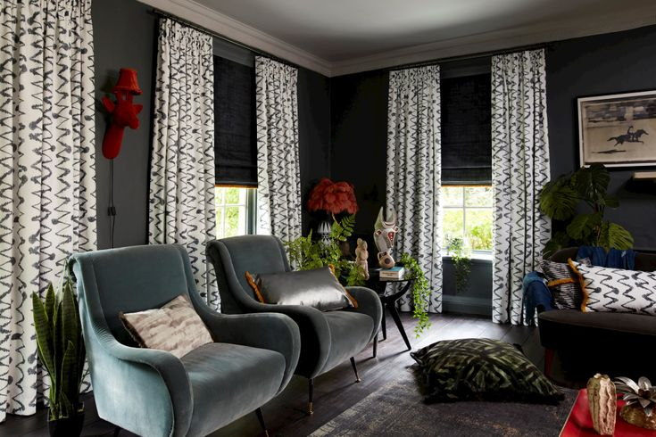 white curtains with grey zig zag print over dark grey roman blinds in grey living room