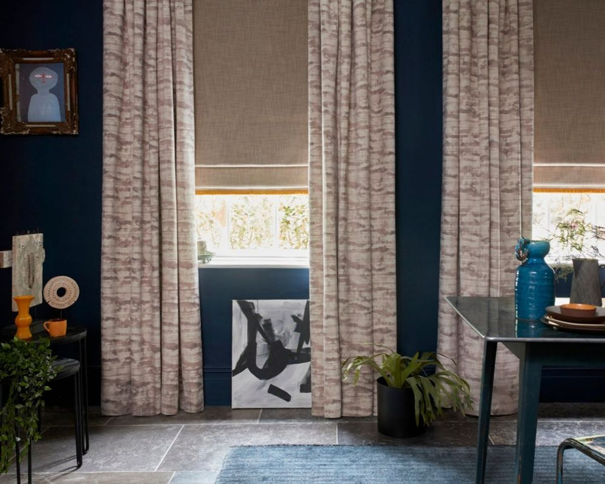 Abigail Ahern collection curtains in Jago Tabac with Amis Buff roman blinds in dining room setting