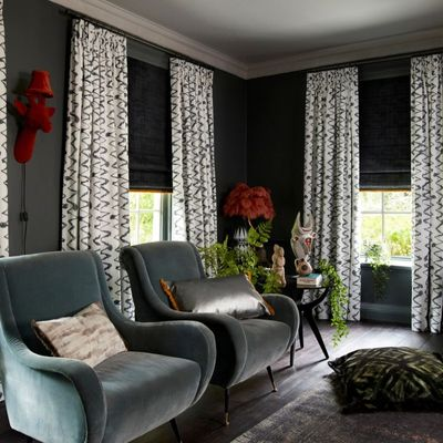 Abigail Ahern collection curtains in Wolfe smoulder with cley mole roman blinds in dining room setting