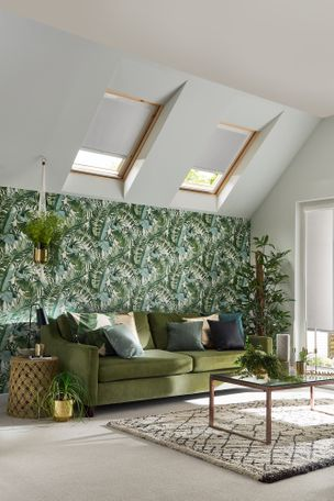 white skylight blinds in a modern living room with leafy jungle print wallpaper