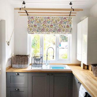 floral print on white roman blind in kitchen