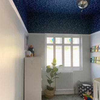 white shutters in children bedroom