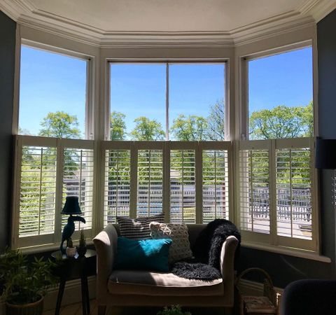 white cafe style shutters in a living room