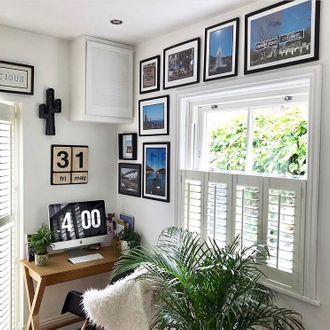windows dressed with white cafe style shutters in a study