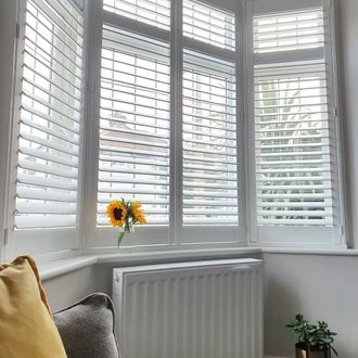 white shutters on bay windows