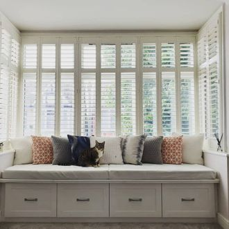 windows in bed room dressed with shutters