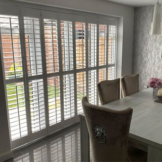 French doors dressed with shutters in living room