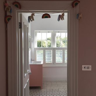 white cafe style shutters in kids bedroom