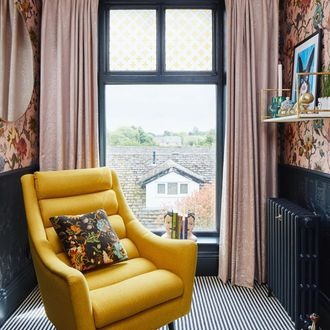coral and white marble effect fabric curtains hanging on victorian, single glazed window