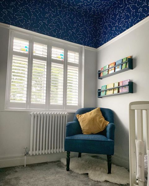 windows in white living room dressed with white full height shutters