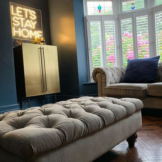 full height shutters in a living room bay windows