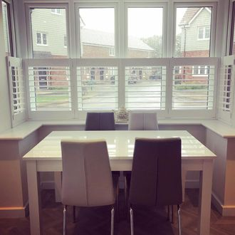 white cafe style shutters in a dining room