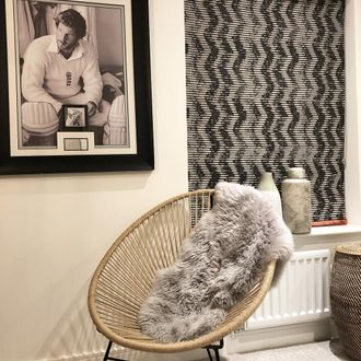 Fade-out black and white wavy line zig-zag printed roman  blind hanging in guest bedroom