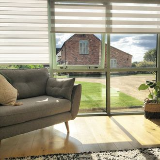 Enlight blinds hanging on the doors of barn house