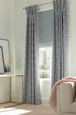 folia sky haze curtains with clarence sky blue roman blinds in living room