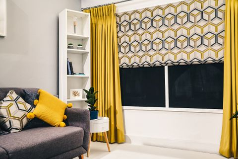 Metro Sauterne Roman blind with Tetbury Mustard curtains in living room