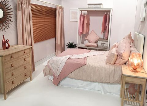 Mineral Blush curtains in a soft pink over Brushed Copper metal Venetian blinds in bedroom