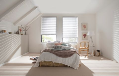White Wooden blinds in bedroom