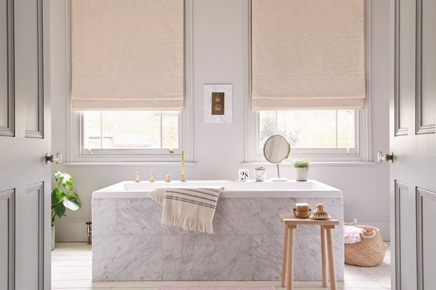 beige roman blinds dressed on windows in a bathroom