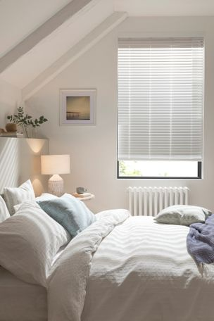 white venetian wodden blinds hanging on a window in attic