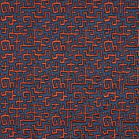 Orange embroidered pattern on dark grey fabric swatch