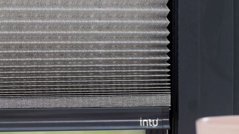 Close up of grey Micro Pleat Pleated blinds dressed on bi-fold doors.