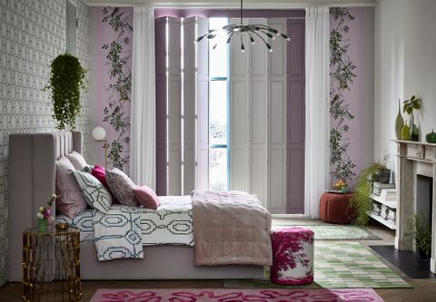 Custom colour solid tracked shutters in bedroom