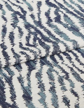 Off white back ground with grey and blue pattern print in living etc campaign