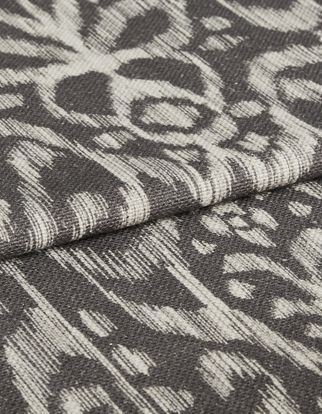 Indah smoke fabric swatch featuring white boho pattern on dark grey background