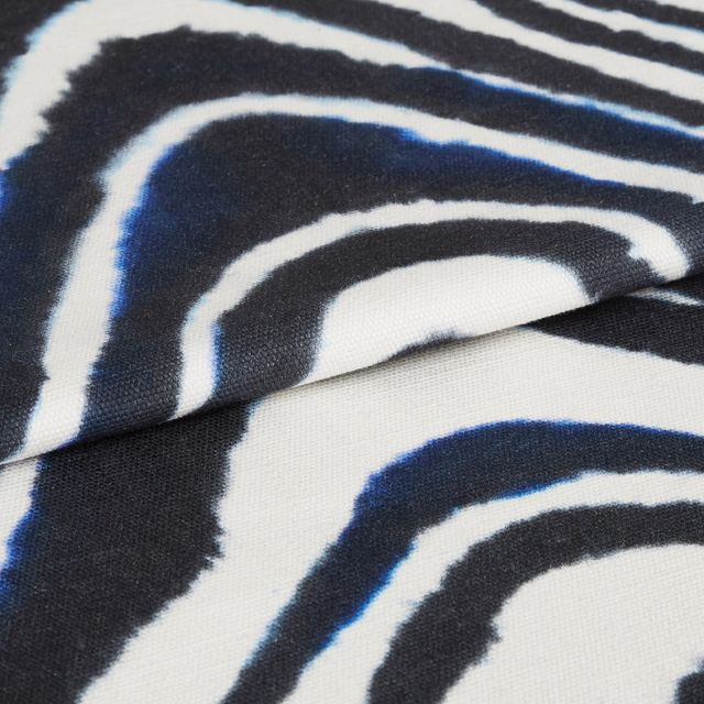 Kovu batik fabric swatch featuring zebra line print on dark blue background